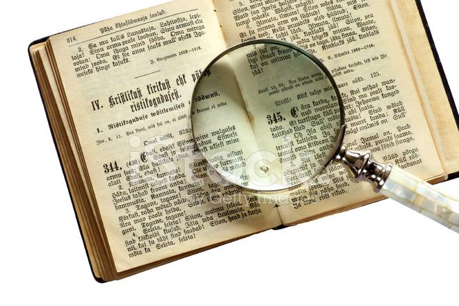 Bible Book With Hand Lens Stock Photos