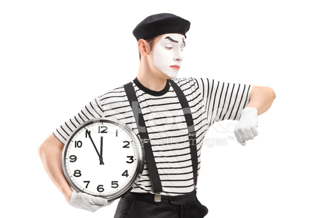 Mime Artist Holding A Clock And Checking The Time Stock