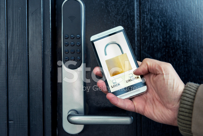 Mobile Phone Is Used To Lock And Unlock Front Door Stock Photos
