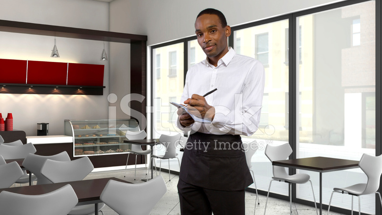 Exterior: Professional Black Waiter Taking Orders IN A Restaurant
