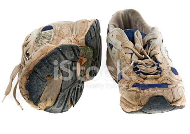 Old Trainers on Bright Background