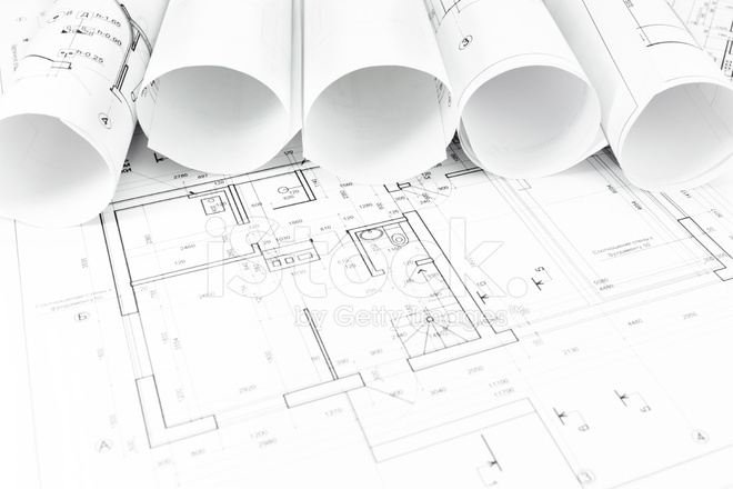 Architectural Background With Rolls Of Drawings Stock Photos