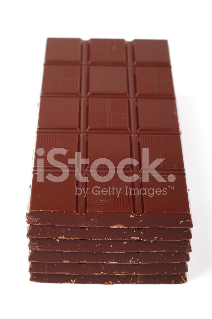 Tavoletta Di Cioccolato Scuro Dello Isolato Su Sfondo Fotografie