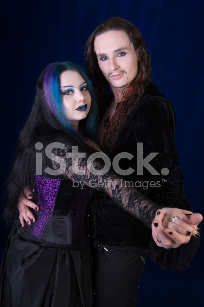 Premium stock photo of vampire couple dancing hands toward