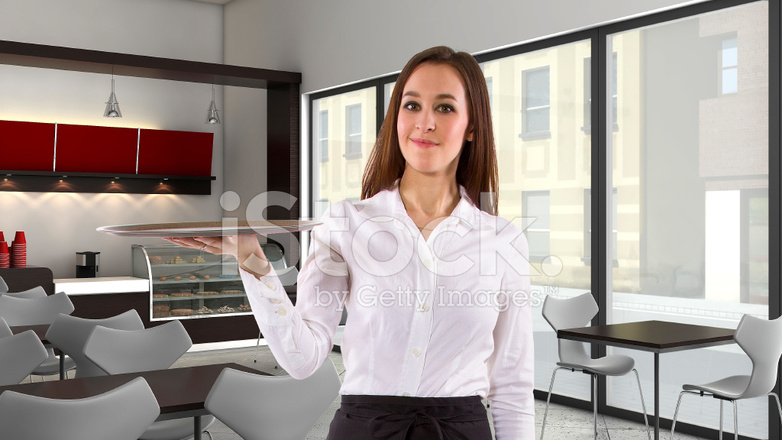 Female Waitress With Tray In A Coffeeshop Or Restaurant