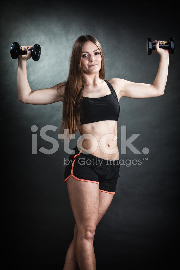 Fille Fitness Photo Épaule de formation fille fitness muscles levage haltères photos