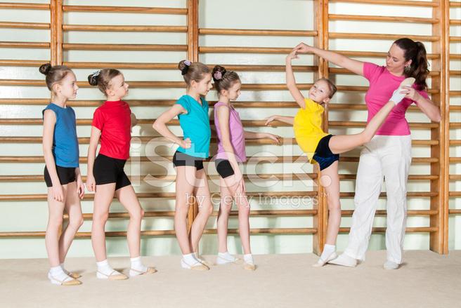 Gymnastics Coach Teaching Little Girls Stock Photos - FreeImages com