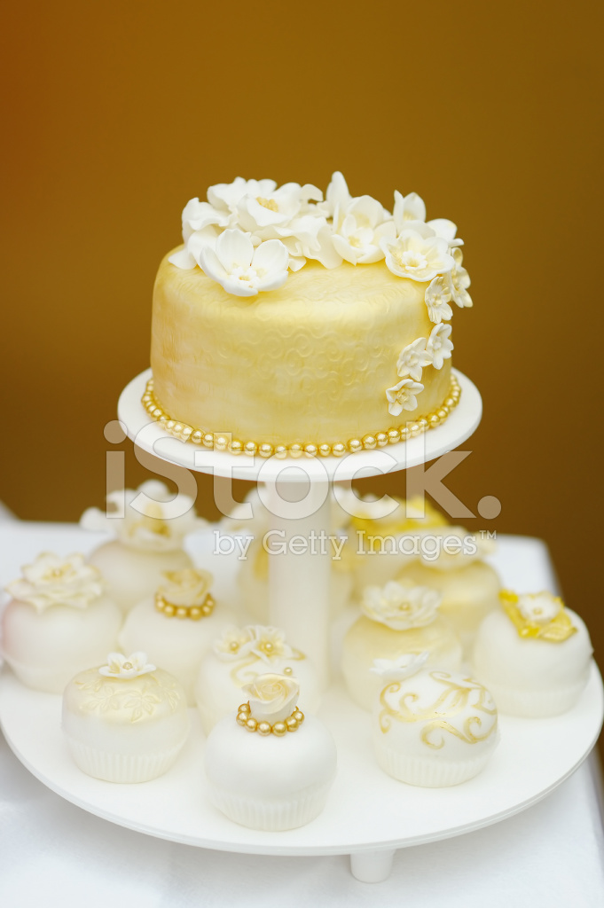 Delicious Lemon Wedding Cake and Cupcakes Decorated With Flowers ...