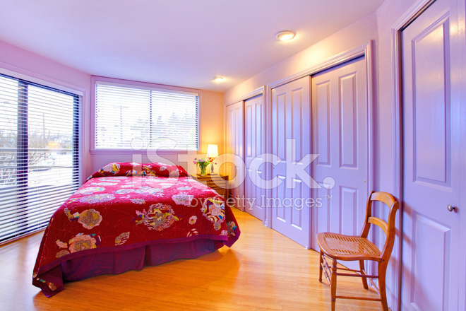 Purple Bedroom With Pink Red Bed Abd Flowers Stock Photos ...