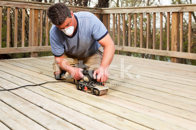 Worker With Belt Sander Sanding Deck Boards Stock Photos