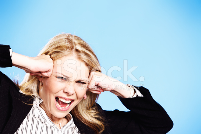 Blonde Businesswoman Screams In Frustration Hands To Her