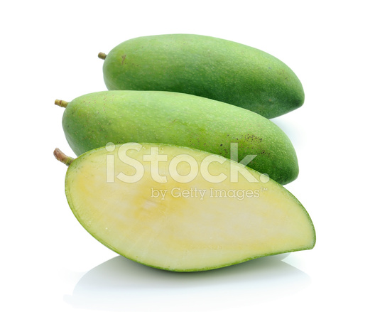 green mango isolated on a white background stock photos