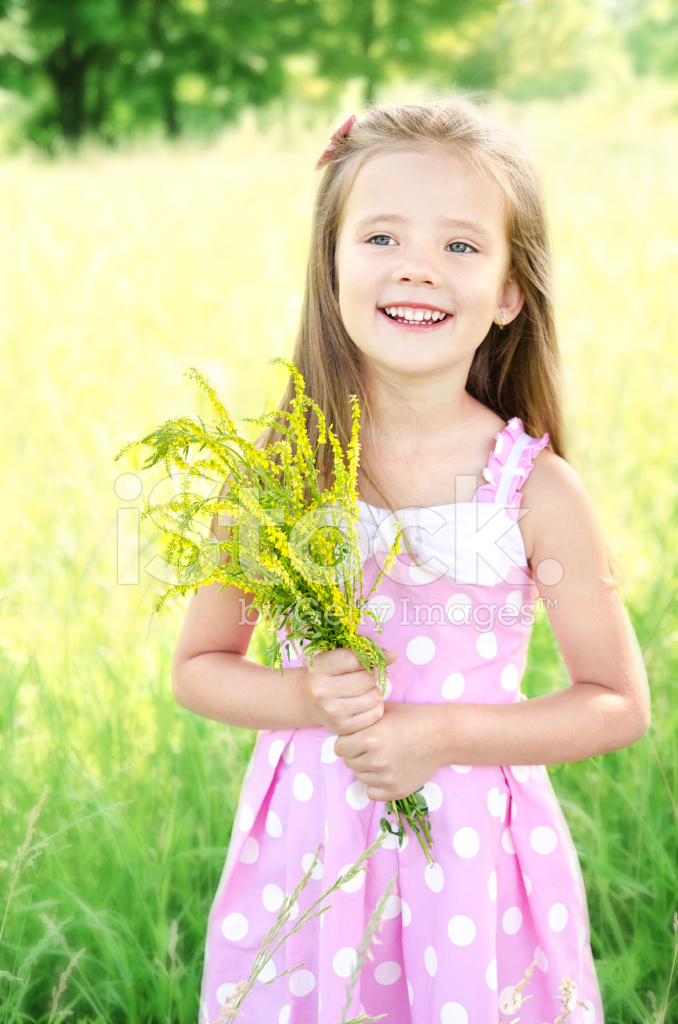Little Girls Nails And Girls On Pinterest: Portrait Of Adorable Smiling Little Girl With Flowers