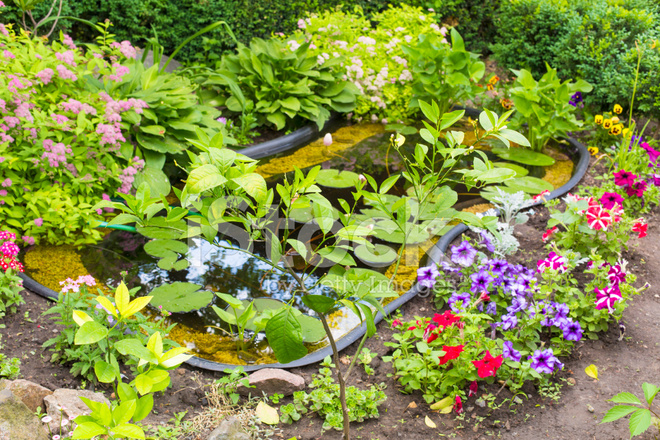 Fragment garden with an artificial pond stock photos for Artificial pond in garden