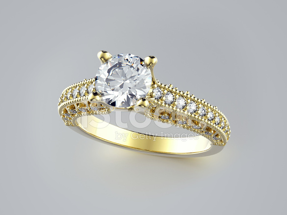 Golden Engagement Ring With Jewelry Background Stock Photos