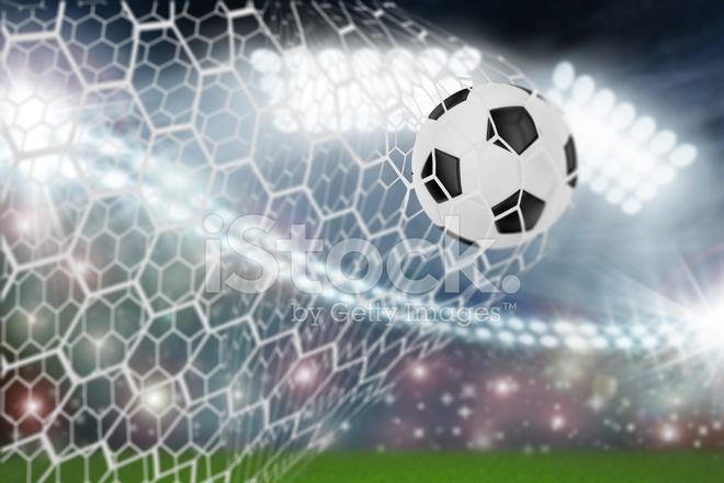 Bola de futebol no gol net fotos do acervo freeimages bola de futebol no gol net stopboris Choice Image