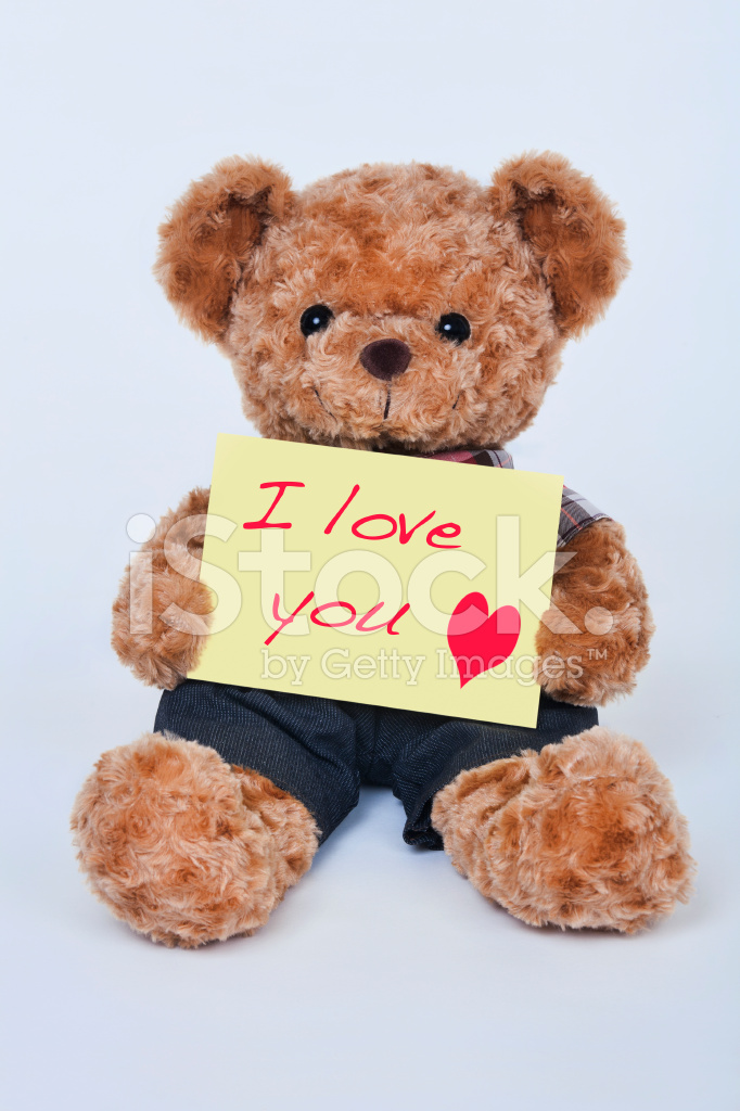 Teddy bear holding a yellow sign saying i love you stock photos premium stock photo of teddy bear holding a yellow sign saying i love you altavistaventures Images