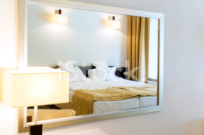 https://images.freeimages.com/images/premium/previews/4287/42871832-close-up-of-two-beds-bedroom-reflects-in-mirror-with-frame.jpg
