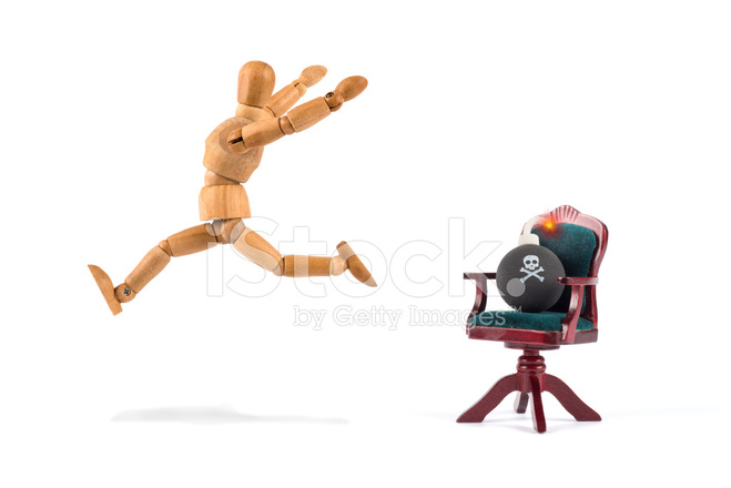 Wooden Mannequin Running Away of A Bomb on Chair Stock Photos ...