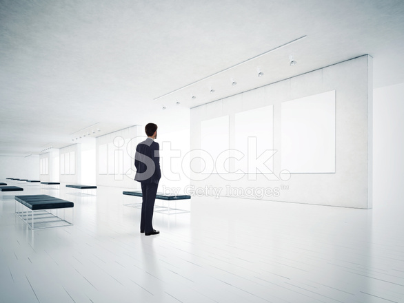 Gallery Room and Man Looking AT Empty Frames Stock Photos ...