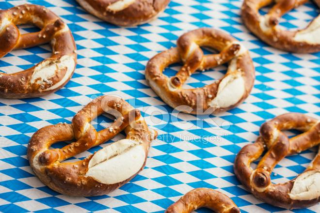 oktoberfest pretzels on bavarian tablecloth stock photos