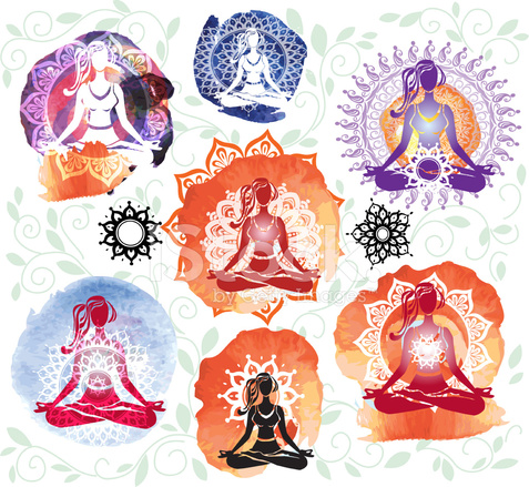 silhouette of woman meditating in lotus position on round