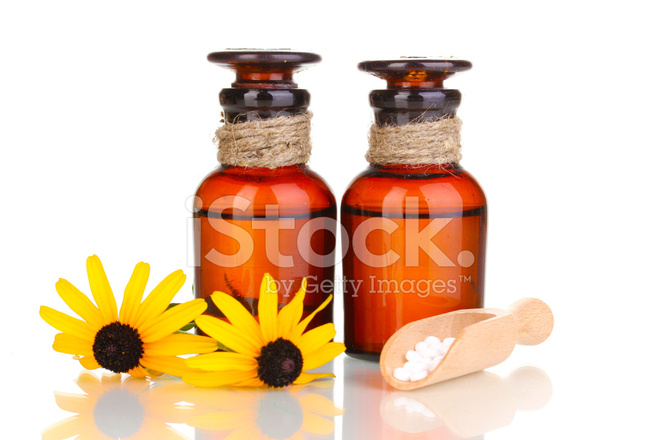 Medicine bottles with tablets and flowers isolated on white stock medicine bottles with tablets and flowers isolated on white mightylinksfo
