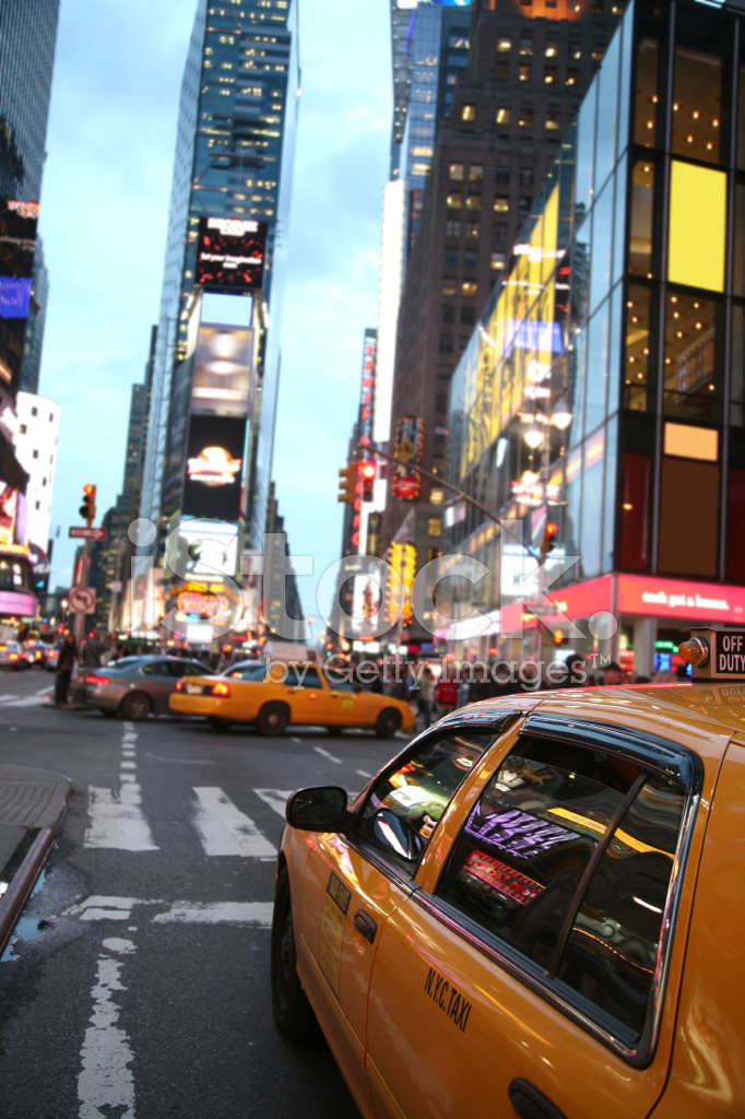 Times square crossroads of the world stock photos for Sites in new york city tourist