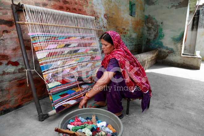 Indian Women Weaving Textile durry Stock Photos