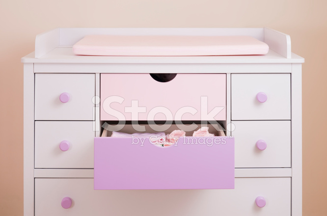 Nursery drawers baby changing stock photos Nursery chest of drawers with changer
