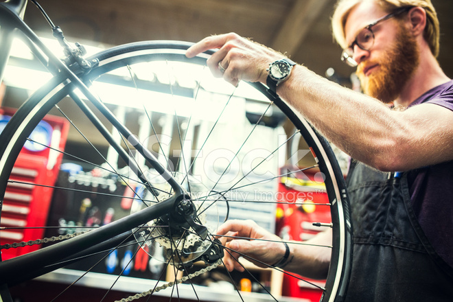 Bicycle Repair Shop and Man Working Stock Photos