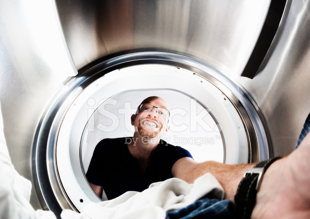 Person Tumble Dryer ~ Smiling man doing laundry seen from inside tumble dryer
