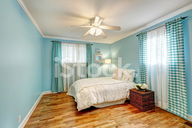 https://images.freeimages.com/images/premium/previews/4700/47006610-cheerful-light-blue-bedroom.jpg
