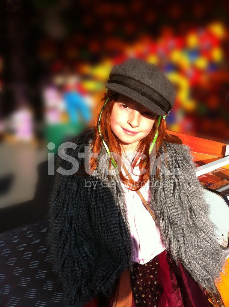 Pretty Girl With Long Red Hair Wearing Dark Grey Cap Stock Photos