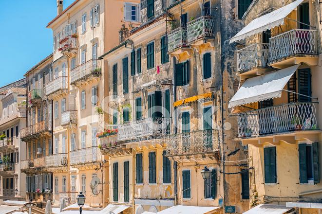 balconies on venetian buildings corfu stock photos