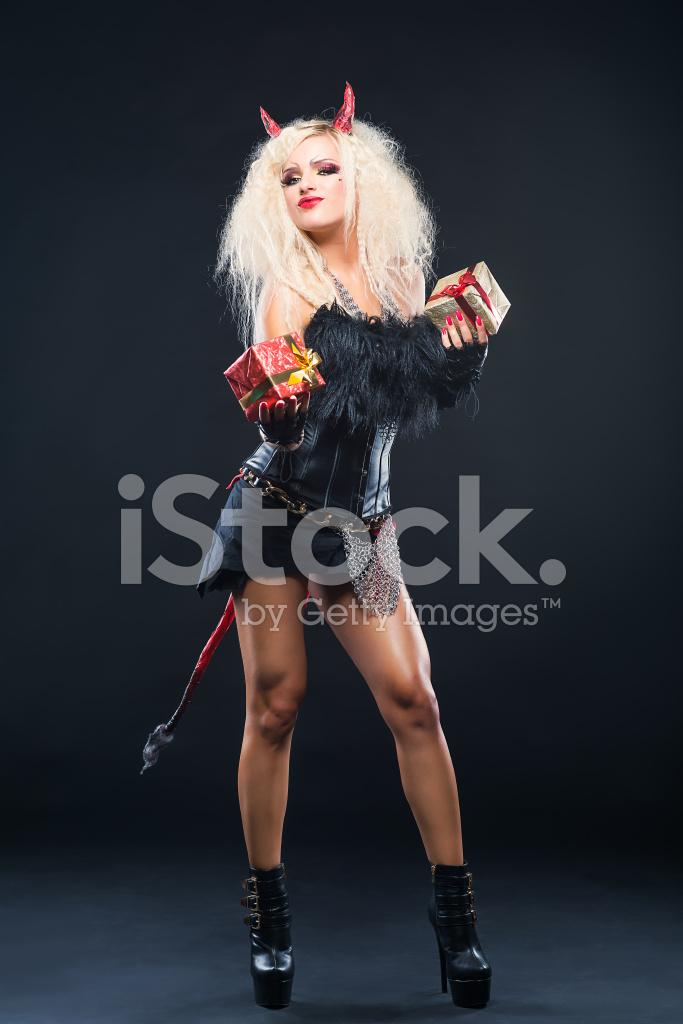 Welches? Teufelin Mädchen Bietet Weihnachtsgeschenke Stockfotos ...