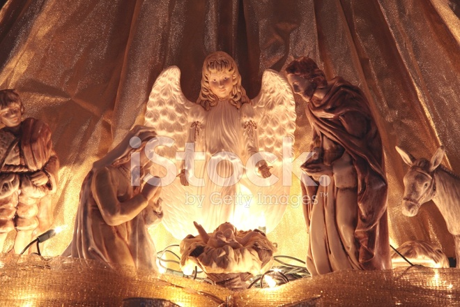 religious christmas nativity scene with angel stock