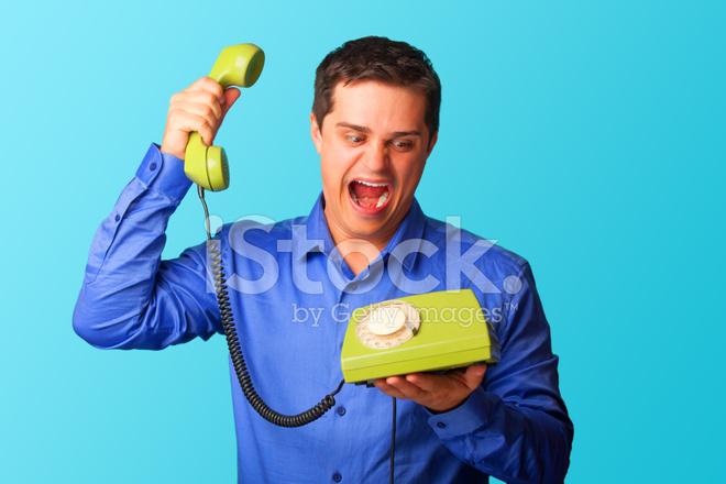 Uomo Sorpreso In Camicia Con Telefono Su Sfondo Fotografie Stock