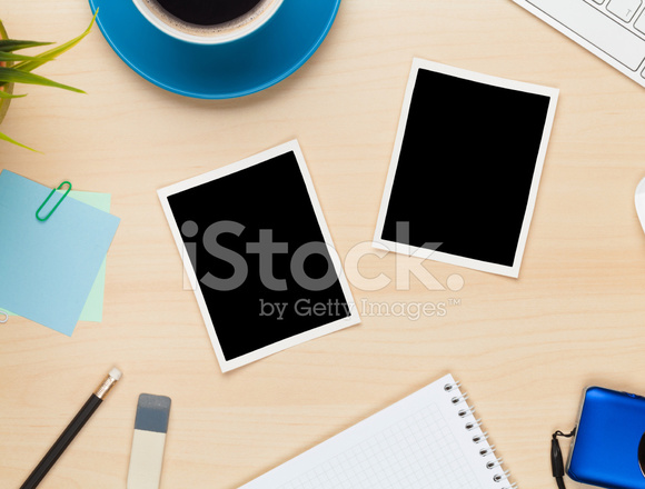 Photo Frames On Office Table With Notepad Computer And Camera Stock