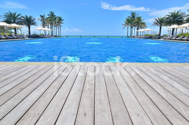 Luxury Infinity Swimming Pool At Tropical Resort Stock