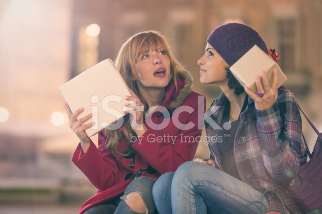 premium stock photo of young couple friends exchange christmas gifts outdoor