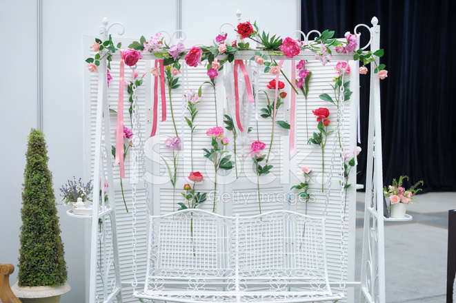 Garden Swing With Flowers As Decoration Stock Photos