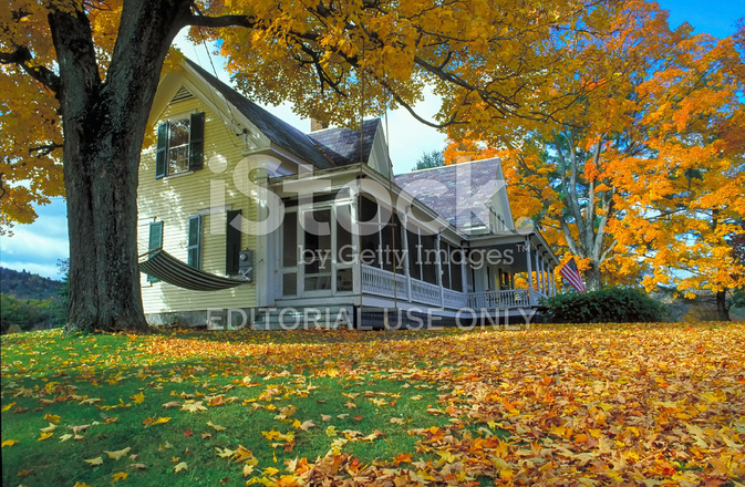New england country home with orange autumn maple leaves for New england country homes