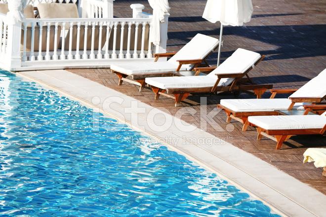 Lounge Sunbeds Near Swimming Pool Stock Photos
