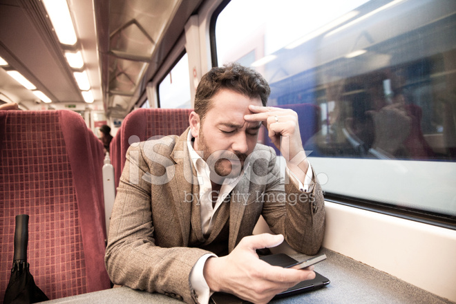 stressed businessman travelling by train and working stock photos