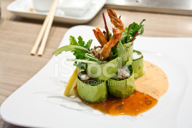 Decorative Sushi On A White Plate With Sauce