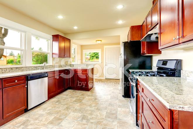 Habitacion Luminosa Cocina Con Electrodomesticos Negros Y Acero - Electrodomesticos-negros