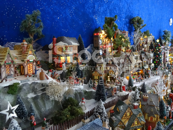 image of model christmas village with miniature houses people