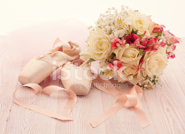 Bouquet of white flowers and ballet shoes on wooden stock photos bouquet of white flowers and ballet shoes on wooden surface mightylinksfo