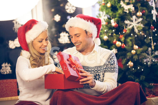 couple opening christmas present
